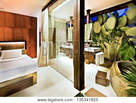 Modern Bedroom Illuminated With Lights Beside The Washroom