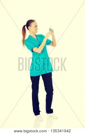 Nurse with a syringe in hand.