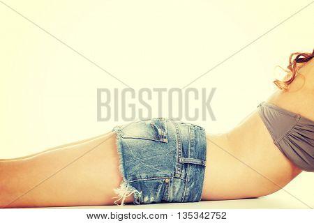 Slim woman body in shorts.