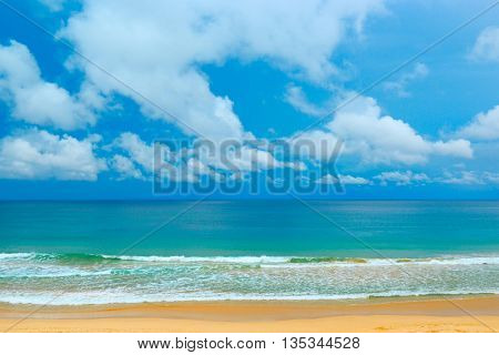 Picturesque coast sea and blue sky. Large waves and yellow sand.