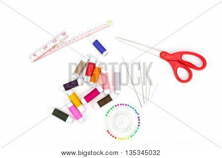 Set of needlework with scissors needle thread measuring tape pin isolated on white background
