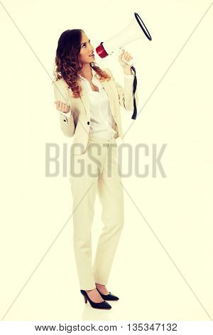 Businesswoman shouting with megaphone.