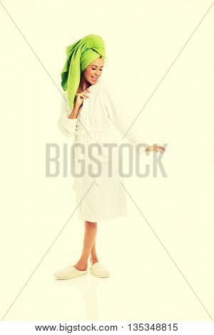 Woman standing in bathrobe