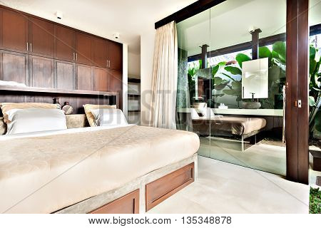 Modern Bedroom With Glass Doors And Windows