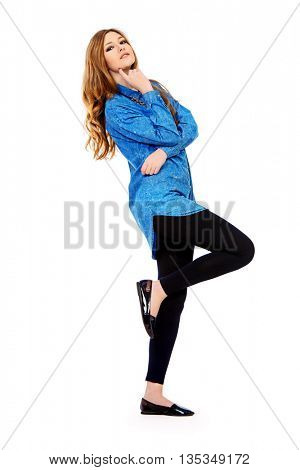 Full length portrait of a pretty smiling girl in casual jeans clothes. Youth fashion. Isolated over white.