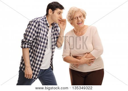 Young guy whispering something to his grandma isolated on white background