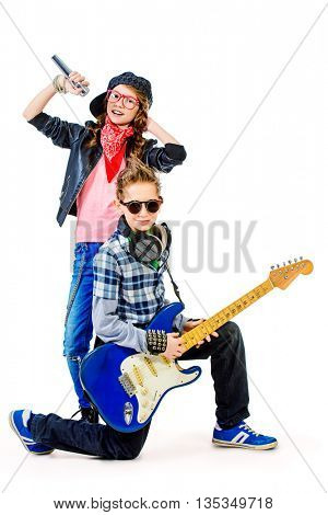 Modern teenagers playing electric guitar and sing on a stage with expression. Isolated over white.