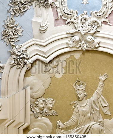 OEIRAS, PORTUGAL - November 4, 2015: Detail of the magnificent rococo stucco covering the ceiling of the Chapel of Our Lady of Mercy in the Palace of Oeiras on November 4, 2015 in Oeiras, Portugal