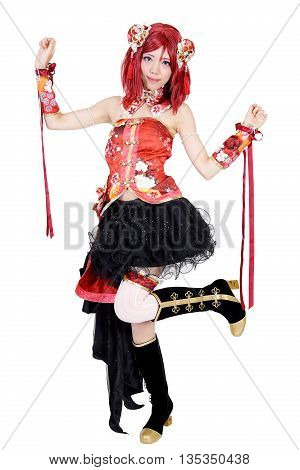 Young asian girl dressed in cosplay costume on white background