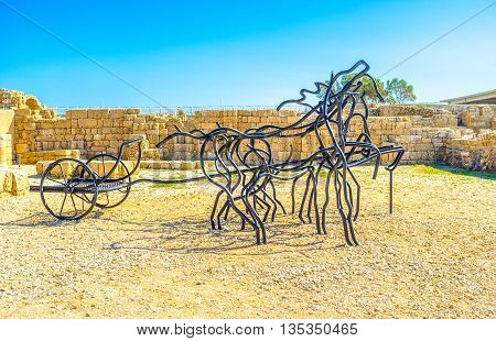 CAESARIA ISRAEL - MAY 19 2016: The modern sculpture depicts two-wheeled horses-drawn chariot popular in Roman times on May 19 in Caesaria.