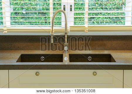 Water Tap And Sink In Kitchen At Home