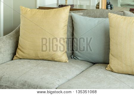 Living Room Interior With Yellow And Gray Pillows On Velvet Gray Sofa