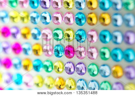 Colorful array of Rhine stones. Rhinestones macro. Shallow depth of field.
