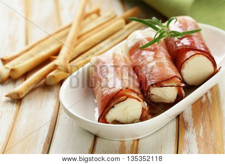 Italian appetizer soft cheese wrapped in parma ham
