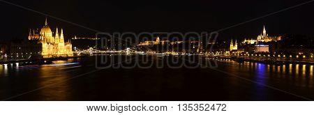 Hungarian landmarks, Hungarian Parliament, Chain Bridge, Royal Palace, Citadella and Danube river in Budapest at night.