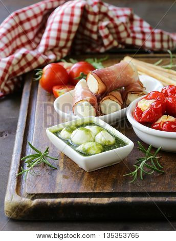 Italian appetizer antipasti made dish - ham, cheese, peppers
