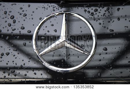 Shenzhen, China - Jun 14, 2016: Close up of the logo of Mercedes-Benz on the car front, taken within a test drive. The German company in Stuttgart is known for luxury vehicle, bus, coach, and truck.
