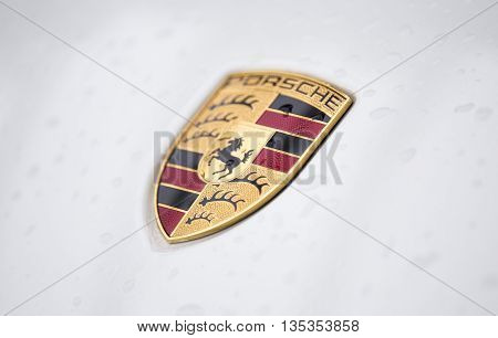Shenzhen, China - Jun 14, 2016: Close up of the logo of Porsche on the car front, taken within a test drive. Porsche is a German automobile manufacturer of high-performance sports car, SUV and sedan.