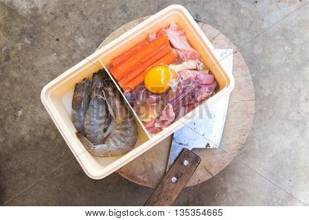 Raw meat preparation in box for picnic