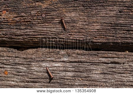 The surface of the wood with old nails stuck.