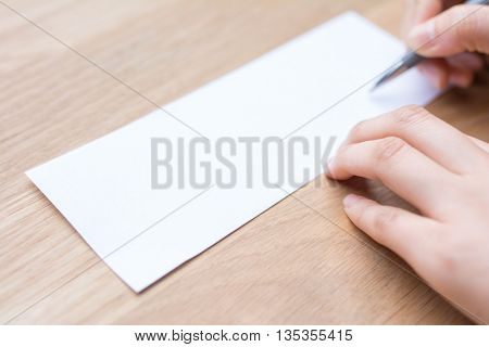 businessman writing on white paper