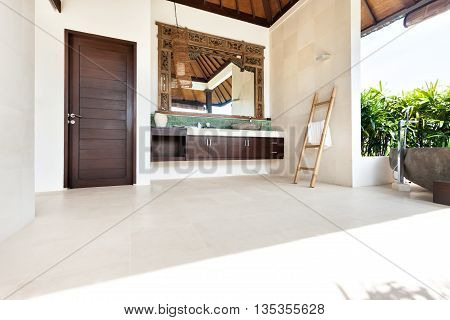 Outside Bathing Area With A Ladder  And A Mirror