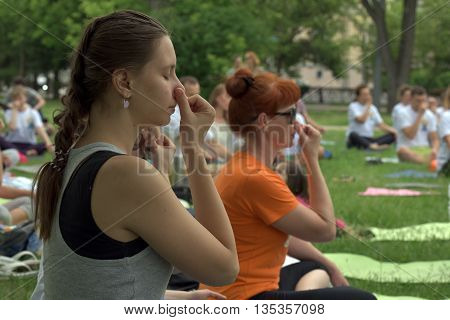 TOMSK RUSSIA - JUNE 19, 2016:: Residents of the city are taking part in the open lesson on Yoga