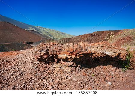 Volcanic rock on Etna on the blue sky, Italy