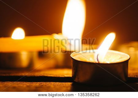 Group of lit candles in the night