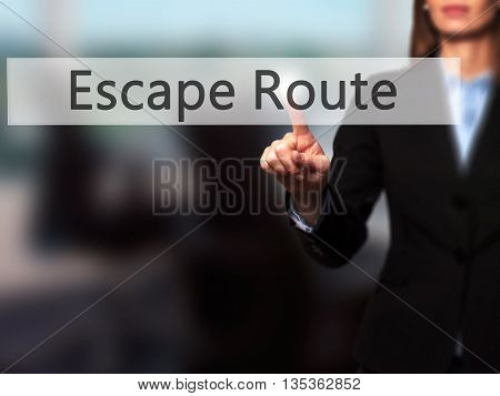 Escape Route - Businesswoman Hand Pressing Button On Touch Screen Interface.