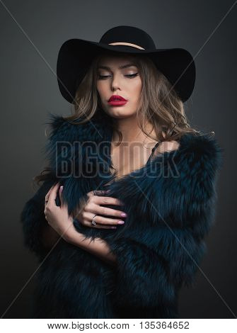 Woman In Black Hat And Fur On A Dark Background Studo Shot Photo