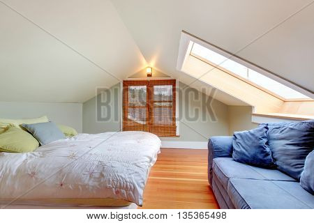 Upstairs Bedroom With Vaulted Ceiling And Hardwood Floor.