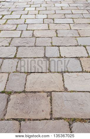 The stone pavement as the background texture Stone pathway in the garden