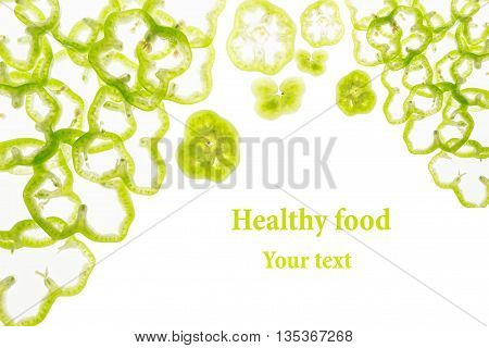 Sliced green pepper rings paprika on a white background. Decorative frame of pepper. Isolated. Food background. Concept art. Copy space.