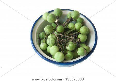 Tropical green pea eggplant on white background