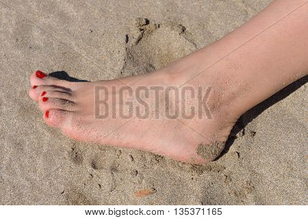 Woman Feet With Red Pedicure Walking On The Hot Sand Of The Beach. Summer Holiday