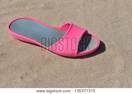 One Pink Slipper For Woman On A Sunny Day On The Beach. Walk On Hot Sand Barefoot, Pleased To Feel T