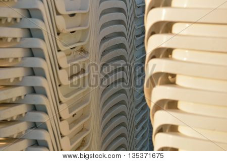 Close Up Of Sunbeds On The Beach Stacked, Ready To Be Put On The Beach To Enjoy The Tourists Of The