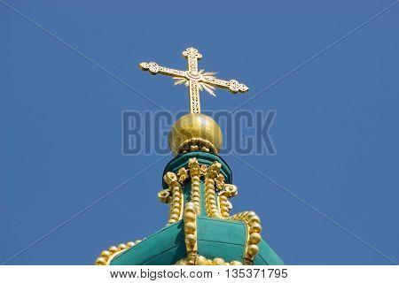 Big golden cross on the church roof