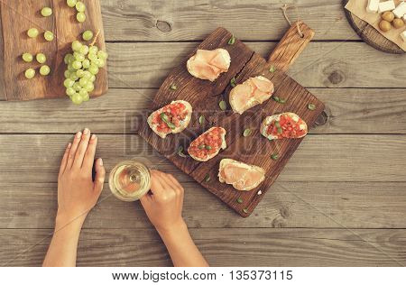 Woman drinking wine and eat appetizers for wine. top view. Relaxing evening