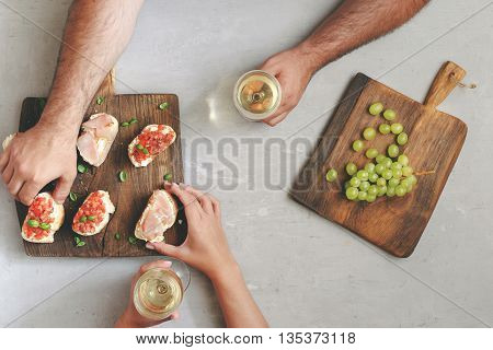 Couple drinking wine and eating appetizers for wine top view