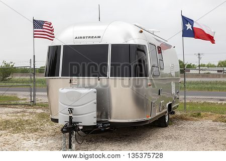 AUSTIN USA - APR 11: Traditional luxury american Airstream trailer at a dealership in Texas. April 11 2016 in Austin Texas United States