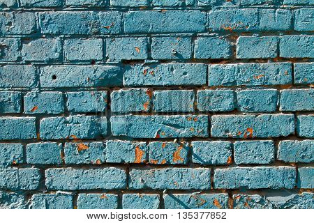 Blue painted brick wall as background or texture
