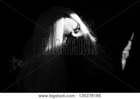 Druid old man face with long silver beard hair black and white bright light on dark background