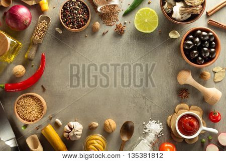 herbs and spices at stone table background