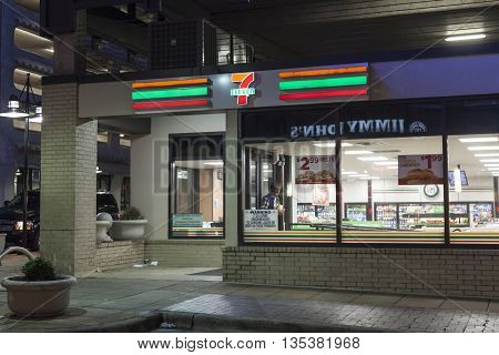 DALLAS USA - APR 9: 7 Eleven convenience store in the city of Dalals illuminated at night. April 9 2016 in Dallas Texas United States