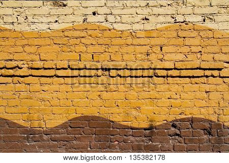 Colorful (yellow beige and brown) brick wall as background texture