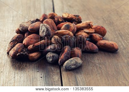 Cocoa beans on a old wooden table