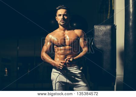 Muscular Man With Jump Rope
