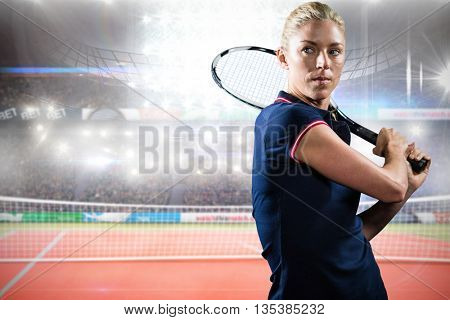 Concentrated sportswoman playing tennis in a court